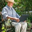 Senior with a laptop — Stock Photo #10535197