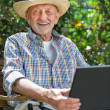 Senior with a laptop — Stock Photo #10535212