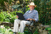 Senior with a laptop — Stock Photo