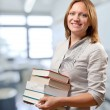 Teacher or student holds the books — Stock Photo #8549430