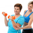 Senior woman in gym - Stock Photo