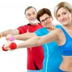 Seniors doing fitness exercises — Stock Photo