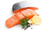 Fresh salmon with parsley and lemon slices — Stock Photo