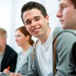 Group of students in classroom — Stock Photo #9274574