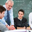 Stock Photo: Teacher with high school students