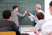 Teacher with high school students — Stock Photo