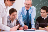 Teacher with high school students — Stock Photo