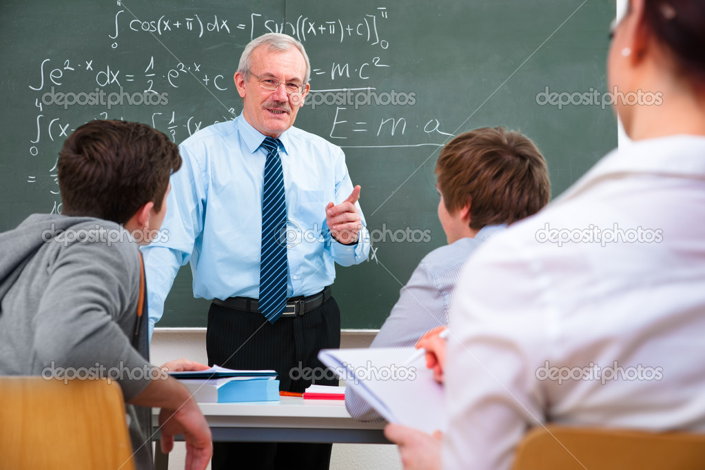 Teacher with a group of high school students  in classroom  Stock Photo #9274706