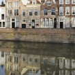 Old houses and canal on dam, middelburg - Stock Photo
