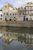 Old houses and canal on dam, middelburg — Stock Photo