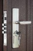 The door lock with keys — Stock Photo
