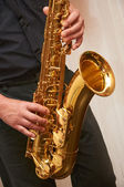 The musician plays a saxophone — Stock Photo
