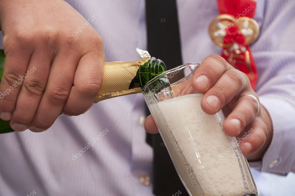 Hands pour wedding champagne  Stock Photo #9856389