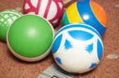 Children's balls on a carpet — Stock Photo