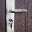 DOOR WITH KEY IN LOCK — Stock Photo #9978788