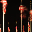 United States flags at night — Stock Photo