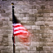 American flag by wall — Stock Photo