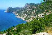 Cliffs and coast to a bay on the island of Ibiza — Stockfoto