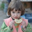 Child with a slice of bread — Stock fotografie