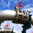 Industrial zone, Steel pipelines and valves against blue sky — Stock Photo #9920169