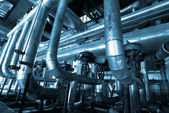 Industrial zone, Steel pipelines and cables in blue tones — Stock Photo