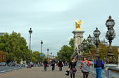 Walking on the bridge Pont Alexander III — 图库照片