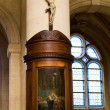 Crucifix with painting on the column — Stockfoto