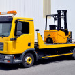 Stock Photo: Transportation of forklift truck