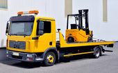 Transportation of a forklift truck — 图库照片