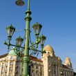Foto Stock: Street lamp with beautiful hotel