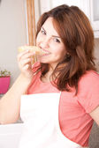 Woman eating bread — Stock Photo