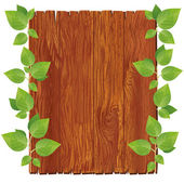 Wooden board with green leaves — Stock Vector