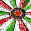 Hit arrow red & green bullseye dart board target game — Stock Photo