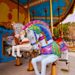 Royalty-Free Stock Photo: Colorful horses in the carousel
