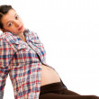 Isolated pregnant girl portrait laying on white — Stock Photo