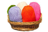 Isolated colorful acrylic fibers in the basket on white — Stock Photo