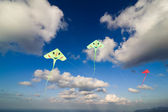Flying colorful kites in blue sky — Stock Photo