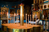 Candles inside the sandpool with jesus and apostles siluette in — Stock Photo