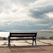 Empty low stool at the coast of the cloudy sea — Stock Photo