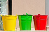 Three buckles in yellow green and red colors on the wall — Stock Photo