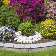 Landscaped flower garden - Stock Photo