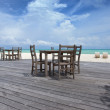 Chairs and table on the beach in front of ocean — Stock Photo