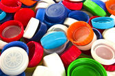Colorful plastic lids — Stock Photo