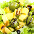 Salad with mango and olives - Stock Photo
