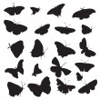 Silhouettes of butterflies — Stock Vector