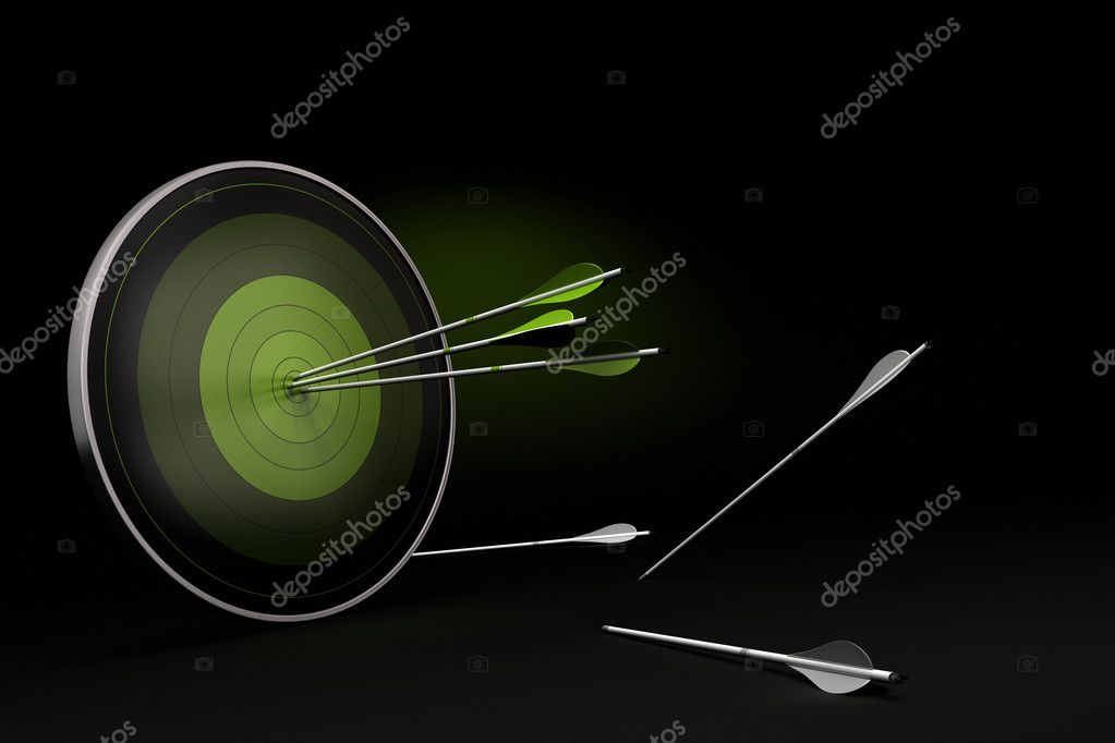 Green target onto a black background with three arrows reaching their goal, and whites arrows on the floor failed to reach their objective.  Stock Photo #8865202