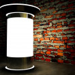 3d blank advertising column on wall at night - Stockfoto