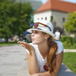 Portrait of a cute young female blowing a kiss, outdoors — Stock Photo #8011942