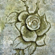 Stock Photo: Old engraver rose in stone