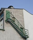 Fire escape stairs on wall of building — Stock Photo
